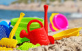 Plastic children toys on the beach sand Stock Image