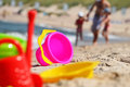 Plastic children toys on the beach sand Stock Images