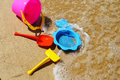 Plastic children toys on the beach sand Stock Photography