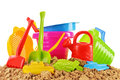 Plastic children toys for playing in sandpit or on a beach isolated white Royalty Free Stock Image