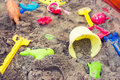 Plastic children toys in sandpit Royalty Free Stock Photo