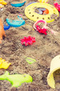 Plastic children toys in sandpit or on a beach Royalty Free Stock Photo