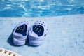 Plastic clogs near the swimming pool. Royalty Free Stock Photo