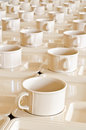 Plastic coffee cups on plates Royalty Free Stock Photo