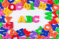 Plastic colored alphabet letters ABC on a white Royalty Free Stock Photo