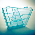Plastic container on a blue background Royalty Free Stock Photo