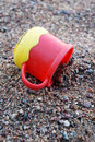 Plastic cup on sand Royalty Free Stock Photography