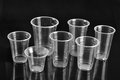 Plastic cups transparent disposal with black background Stock Photos