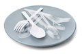 Plastic cutlery closeup on plate Stock Photo