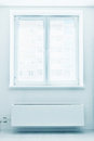 Plastic double door window with radiator under it white domestic room Royalty Free Stock Images