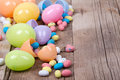 Plastic easter eggs and candy Stock Photo