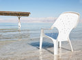 Plastic easy chair in the shallow waters of the world famous de dead sea israel sunny day Royalty Free Stock Photos