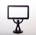 Plastic figurine of a man with a placard on white background Royalty Free Stock Photo