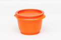 Plastic food container orange color on white background Royalty Free Stock Images