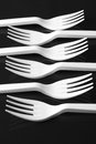 Plastic forks white on black background Stock Photo