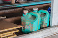 Plastic gallon old dirty green oil in garage Royalty Free Stock Photo
