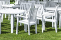 Plastic garden furniture white on a lawn Royalty Free Stock Photography