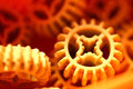 Plastic gears orange texture Royalty Free Stock Photo