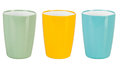 Plastic glass for juice green yellow and blue Stock Photo