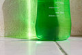 Plastic green bottle on the floor which is caused by the reflection of sunlight Stock Images