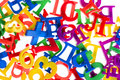 Plastic letters and numbers close up Stock Image