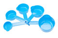Plastic measuring spoons set on white background Royalty Free Stock Photography