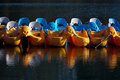 Plastic pedaloes tied up out of season - UK Stock Photo