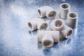 Plastic pipe fittings on metallic surface construction concept Royalty Free Stock Photo