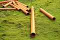 Plastic pipe on grassland Stock Image