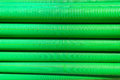 Plastic pipes detail stacked green colored drainage in Royalty Free Stock Photos