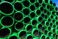 Plastic pipes stacked green black colored drainage in detail Royalty Free Stock Photography