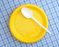 Plastic plate and spoon Royalty Free Stock Image