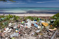 Plastic pollution on caribbean beach trash has washed up a remote in the sea breaks down into tiny pieces that eventually enter Royalty Free Stock Photos