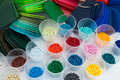 Plastic polymer granulate several dyed granulates in laboratory Royalty Free Stock Image