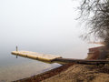 Plastic pontoon in the fog Royalty Free Stock Photo