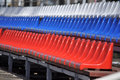 Plastic seats in the stadium at three series painted colours of russian flag Royalty Free Stock Photo