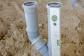 Plastic sewer pipe are leveling with level tool on a constructio