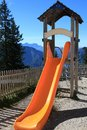 A plastic slide on childrens playground Royalty Free Stock Photo