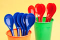 Plastic spoons and cups Stock Photo