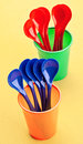 Plastic spoons and cups Royalty Free Stock Images