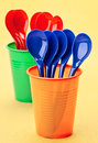 Plastic spoons and cups Royalty Free Stock Photo