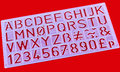 Plastic stencil a close up of a lettering Royalty Free Stock Photo