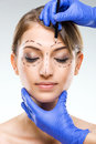 Plastic surgery beautiful woman face with surgical markings Royalty Free Stock Photography