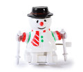 Plastic toy mechanical snowman on skis isolated Royalty Free Stock Images