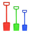 Plastic toy shovels on white background Stock Image