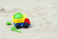 Plastic toys the close up of toy truck on sandbeach Stock Images