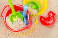 Plastic toys in sandpit Royalty Free Stock Photo