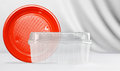 Plastic transparent container and red plastic plate on white background take away concept Royalty Free Stock Images