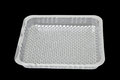Plastic tray on black background Royalty Free Stock Image