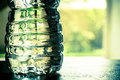 Plastic water bottle with nature window in background Stock Photography